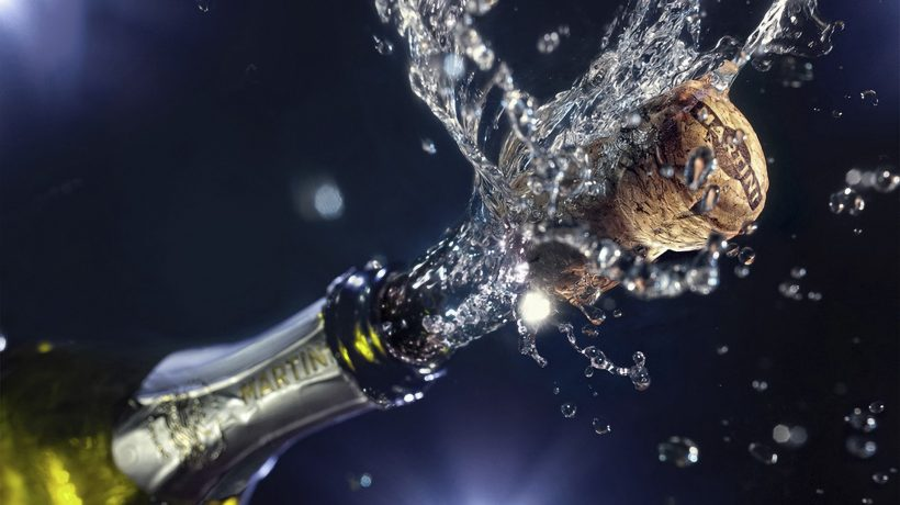 Why do we celebrate with champagne or sparkling wine?