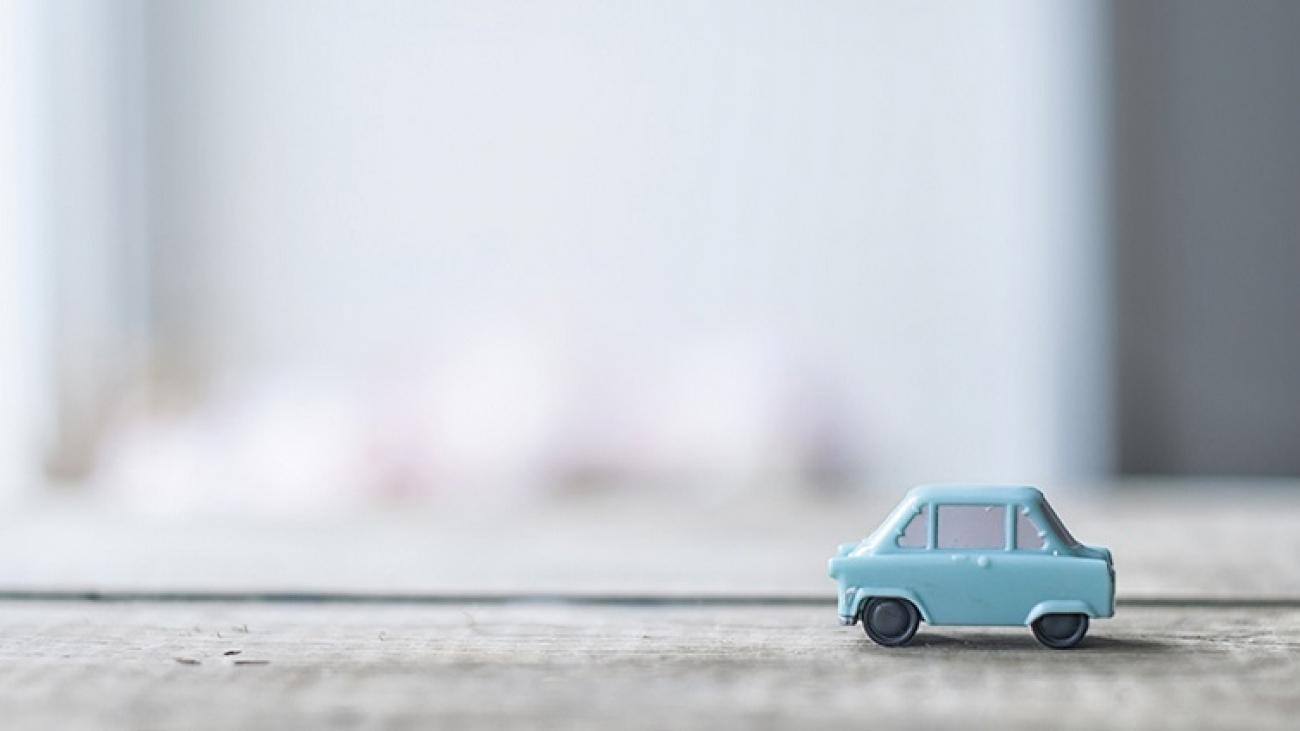 Toy model of retro car in nursary room